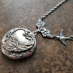 Hearts and Flowers Victoriana Filigree Locket Exclusively by Enchanted Lockets, Mother's Day Locket. $25.00, via Etsy.