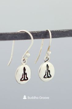 Dainty dangling earrings feature the iconic silhouette of Buddha in meditation, encouraging peace and inner serenity. Buddha Jewelry, Lotus Design, Buddhism, Sterling Silver Earrings, Pendants, Symbols, Silhouette, Drop Earrings, Pretty