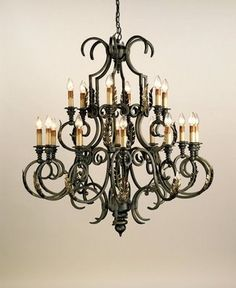 This Chandelier is a blacksmith's dream - large in scale and large in imagination. Hand-forged metal is used to create a fine example of the craftsman's art finished in Bronze Verdigris with highlights of Gold Leaf. 18 lights. Measures 48rd x 52h.