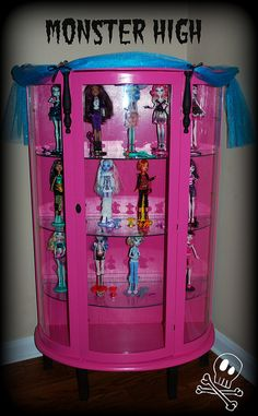 Monster High Display Cabinet ** I WANT THIS FOR MY GIRL'S ROOM it would be perfect for all the MH barbies they have!