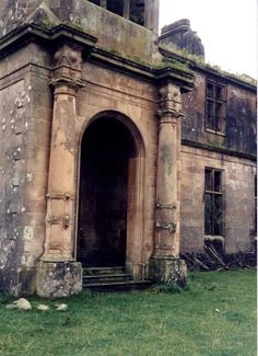 The decaying Poltalloch House - Built in 1853, this once grand Scottish estate fell into ruins in the 1950s when the owners dismantled the roof to avoid paying heavy taxes. Today its walls stand amongst brambles and vines, ravished by the elements as well as nature - Kilmartin, Scotland.