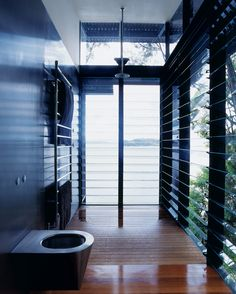 James-Robertson house by Rob Brown. The master bath is open to the surrounding environment | http://www.dwell.com/house-tours/slideshow/inclined-relax#10