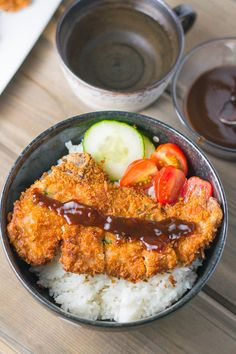 Tonkatsu (or Japanese style breaded pork cutlet) by salu-salo: chops coated with flour, dipped in eggs, coated with Panko and then fried until browned and cooked. #Pork_Cutlets #Japanese