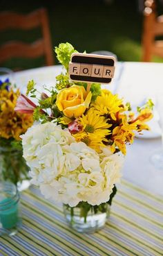 Scrabble lovers use Scrabble tiles to spell out table numbers! A cute way to incorporate a favourite game, as a personalized touch, to an event's decor!