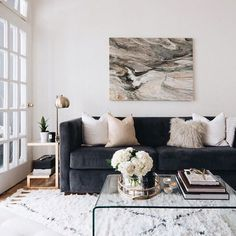Get this look: Sofa Pillow 1 Pillow 2 Rug Coffee Table Floor Lamp Side Table Art Flowers Wishbone