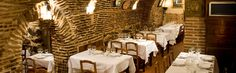 """El Restaurante Botin ......   In 2000,  I visited Spain with my brother.  One of our must do's was to eat at the Botin.  It is, according to the Guinness Book of Records the oldest restaurant in the world, dating from 1725.  We were honored with a table in the """"bodegas"""" or cellars. This portion of the Restaurant is literally the foundation of the original building.  We set next to a wall built in the 1700's."""