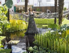 Miss Sweden, Camilla Hansson, appears to float over the World Vision garden at the RHS Chelsea Flower Show. The popular summer season event, which attracts royals and celebrities begins in earnest on Tuesday