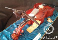 Black widow plane and violin cake! - Cake by Gadget Cakes