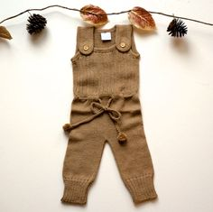 Lovely baby knit fall romper. overall style with button closures and pom pom ties. all the heart eyes over here!