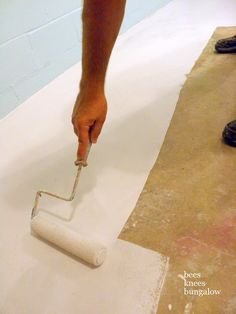 Spruce up a basement laundry room by staining the concrete floor.