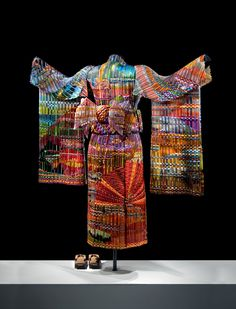 "Glass, Erick Markow, Artist, Autumn Sunset Kimono (back), woven glass  5.5 ft. tall with arm span of 4.5 ft.  ""This is the first in a series of four freestanding life-size kimonos representing the four seasons during different times of day. This kimono is made of 19 separate pieces of woven glass supported by a metal mannequin.  At 125 pounds, this kimono is the largest woven glass sculpture in the world.""  narrative from website"