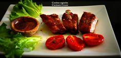 Costine arrosto con salsa piccante e pomodori confit