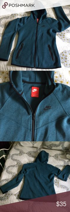 Nike tech fleece zippered hoodie! Like New! This is a beautiful hooded soft tech fleece with black trim. Water resistant. Thumbhole sleeves. Side zippered pockets. Made of 75% Cotton and 30% Polyester. Nike Jackets & Coats