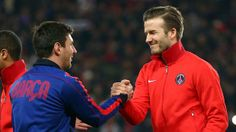 Messi shakes hands with Beckham