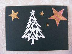 voorkant dubbele groene kaart met stans(kerstboom) en stickers