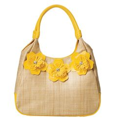 """Avon: Floral Dream Handbag intro special $19.99. Straw-look with leatherlike and bead accents. Magnetic-snap closure. Fully lined with one zip and two slip pockets. 9"""" H x 12"""" W x 4 1/2"""" D; handle drop, 7 1/2""""."""