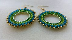 Lovely fresh green and golden earrings. Very lightweight, hypoallergenic earhooks. https://www.etsy.com/listing/126298480/green-handmade-beaded-hoop-earrings