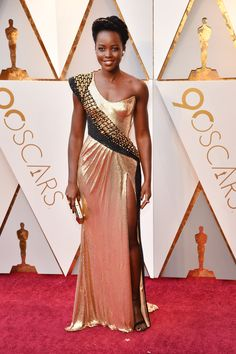 Lupita Nyong'o in custom Atelier Versace...Pretty, imagine in bridal fabric with embellishments that fit the wedding theme. Adjust to fit your theme.