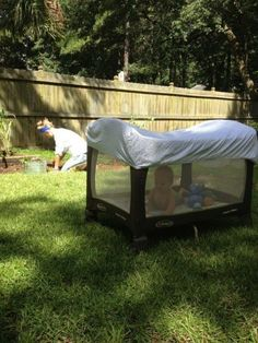 Take your baby outside in the pac n' play, but use a fitted crib sheet to cover the top to keep bugs out. Great idea!