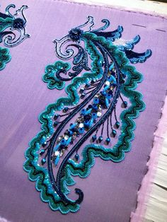 Home stretch, filling with some ribbon and vermicelli white I think #sewing #beading