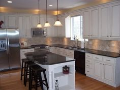 Painted and glazed oak cabinets make such a difference. I love the white!