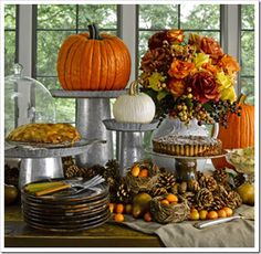 Galvanized tall cylinders topped with tin pie plates  to make cake plate/serving platter make for a more rustic Thanksgiving dessert table
