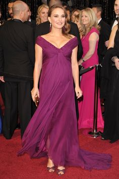 Pin for Later: 85 Unforgettable Looks From the Oscars Red Carpet Natalie Portman at the 2011 Academy Awards Natalie Portman was the picture of mother-to-be glamour at the 2011 show — she looked stunning in a violet draped Rodarte gown.