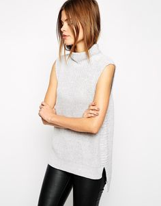 This is 2015 hottest staple piece for winter- grab a sleeveless high neck long line knit and everything else is easy