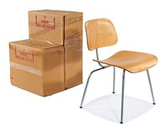 A 1952 Birch (wood) Eames DCM in its original box, one of a pair, the ultimate in collecting vintage Eames