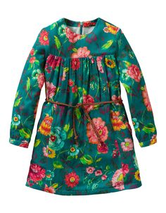 This dress with hand-painted flower print is completed with a twisted belt. With hidden zipper on the back.