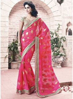 Interest oceans of attention adorned in this vivacious hot pink faux georgette saree. This saree is decorated with patch border work....