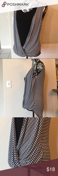 """Cha Cha vente black & white stripe crossover top Cha Cha vente black & white stripe sleeveless crossover top drapes over attached black knit scoop neck top. Measurements laying flat armpit to armpit 18 1/2"""", length in the front 25"""", longer in back at 28"""". Excellent used condition. Cha cha vente Tops"""
