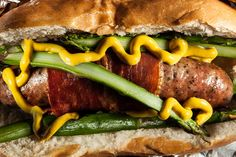 Green and Red: Wrap your sausage of choice with prosciutto, then stuff it into a roll with blanched asparagus spears and a squeeze of yellow mustard.