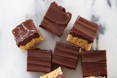 Rice cereal gives the classic combo of chocolate and peanut butter a satisfying crunch. The trick to making these crispy chocolate peanut butter squares is working quickly—otherwise, the sugar may harden before you press the mixture into the pan. Photography by Ryan Brook.