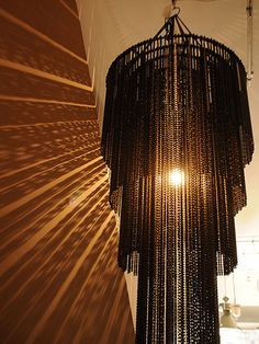 Impressive reclaimed chandelier produced from 600 used bicycle chains. Created by Laurence Van Seventer http://www.elemental.uk.com/lighting/bicycle_chain_chandelier_1746/product#