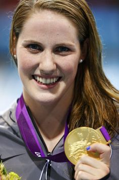 Missy Franklin of the U.S. poses with her gold medal after winning the women's 200m backstroke final with a world record during the London 2012 Olympic Games at the Aquatics Centre August 3, 2012.