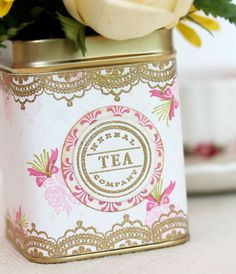 DIY Vintage Tea Tins | Damask Love Blog #teatincenterpieces #DIYteatins #vintageteatins; Just bought a tin of English Breakfast... not that I need the tea, but I had to have the tin!  Sidenote -- the bags are HUGE!  Very pretty :)
