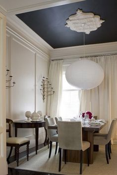 A Noguchi Akari lantern and a pitch-dark ceiling add a modern note to this dining room by the McGill Design Group. Different fixture for sure but love the drama of the black ceiling and medallion Dark Ceiling, Colored Ceiling, Ceiling Trim, Accent Ceiling, Ceiling Rose, Modern Ceiling, Ceiling Panels, Ceiling Decor, Ceiling Design