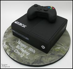 "This cake was for a young gent who knows his stuff and wants to be a game writer, and THIS apparently is the 2014 model out later this year … (Oh, and the marbled board I fell a little bit in love with :) ) 9"" choc mud with RKT controller on a 14""..."