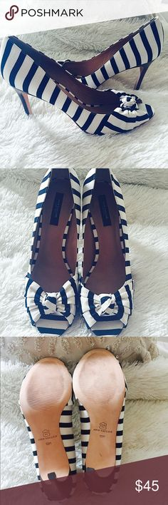 "Ann Taylor navy and white striped heels!✨ Absolutely gorgeous Ann Taylor navy and white striped peep toe heels! Excellent condition,I wore these only once. These are so pretty and I love them so much,but they deserve to be with someone who actually has chances to wear them. Size 10,4"" heel. Make these yours today!!😊✨💖💕👠 Ann Taylor Shoes Heels"
