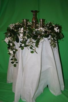 Unity Candle: Here is a beautiful, natural look for the table. If you have silk vines/flowers you can then easily transfer them from here to your reception for instant decoration as well (bride table, cake table, gift table…). Your choice of candles.