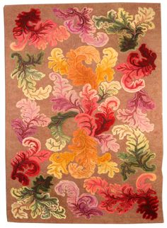 A hooked rug BB4482 - by Doris Leslie Blau.  A mid 20th century hooked rug, the light brown with enormous colorful curving leaves overall ...
