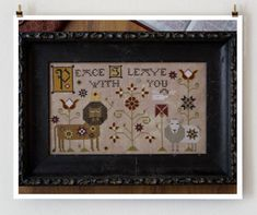 Viktor and Irina cross stitch pattern by Plum Street Samplers at thecottageneedle.com Lion and lamb March quaker hand embroidery by thecottageneedle