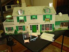 I still have this doll house, complete with all the furniture even silverware still on the plastic ~~~ Vintage 1960s Marx Tin Litho Dollhouse Mansion