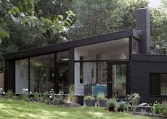 House Made From Black Bricks By Takero Shimazaki and Charlie Luxton