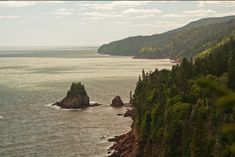 FUNDY NATIONAL PARK • Alma, New Brunswick   Located on the Bay of Fundy, this rugged coastal area is famous for having the world's highest tides, which rise up to the height of a four-storey building. At low tide, you can walk along part of the seabed of the Atlantic Ocean. The park also has over 100 kilometres of hiking and biking trails that lead to more than 25 waterfalls.   Photo: Andrea Schaffer, Flickr