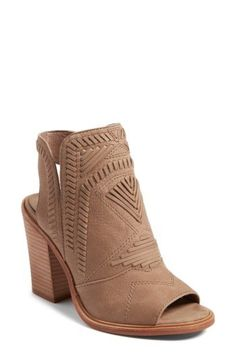 166dfe0e743 Intricately patterned whipstitching lends Western-inspired style to a  versatile peep-toe bootie elevated