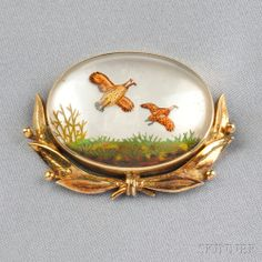 14kt Gold and Reverse-painted Crystal Brooch, depicting game birds in flight, the mount with garland of laurel leaves, lg. 1 1/2 in.