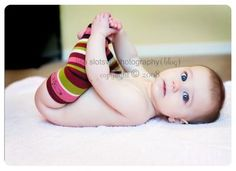 cute 6 month old.. Baby G does love his toes... maybe get him the football baby legs?