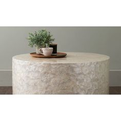 "Rowden Off-White Wood and Capiz Round Coffee Table 31"" diameter too big"